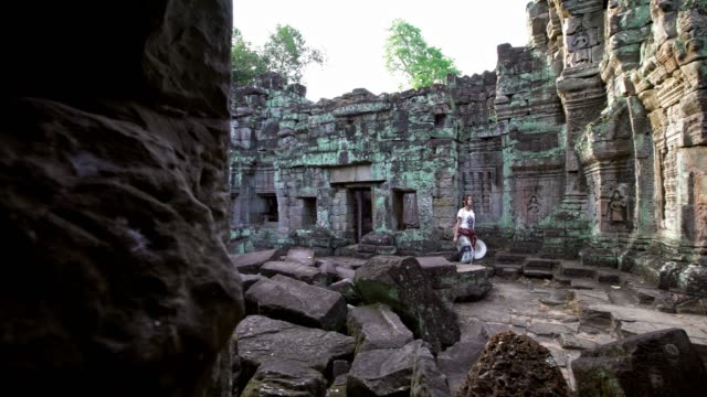 4K, Beautiful asian woman take a walk in ancient Hindu temple of Preah Khan.