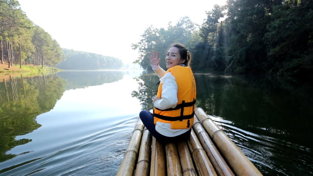 Beautiful asian women tourists on bamboo raft in the morning at Pang Ung video