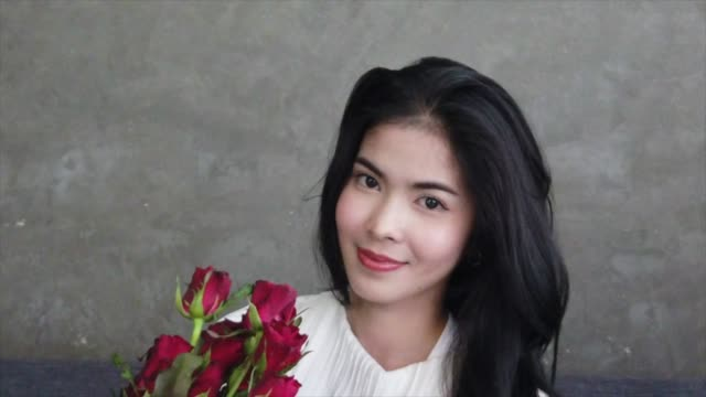 Beautiful Asian Women with Roses in Valentine's Day