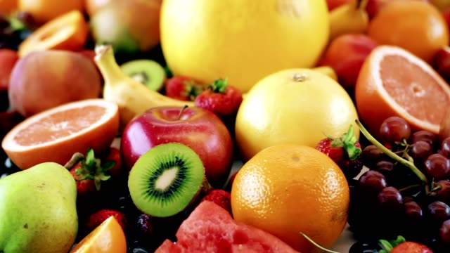Beautiful Assorted Fruits 4K Rotating table of fruits pear stock videos & royalty-free footage