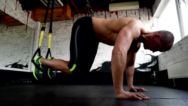 beautiful athlete is pushed on trx straps video