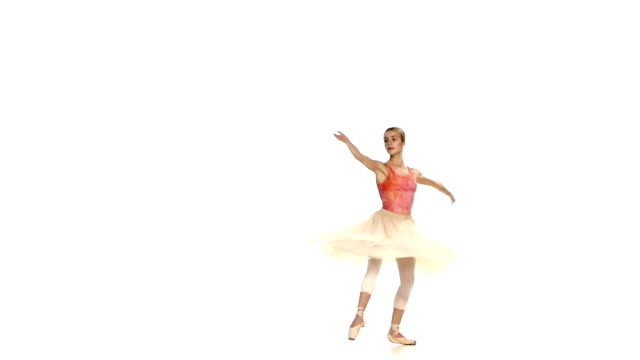 beautiful ballerina making dance trick, battements tendus, on white background, slow motion - tutu bildbanksvideor och videomaterial från bakom kulisserna