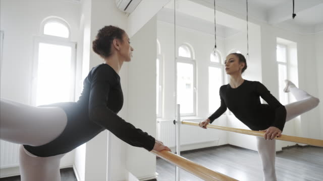 Beautiful ballerina worming up. video