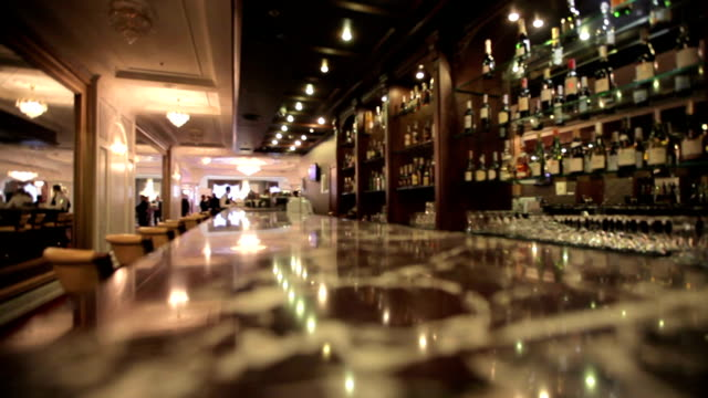 beautiful bar in the restaurant and a bottle of alcohol beautiful bar in the restaurant and a bottle of alcohol. bar counter stock videos & royalty-free footage