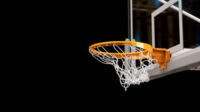 vídeos y material grabado en eventos de stock de hermosa baloncesto bola golpea cerca de canasta red lenta. bola vuela girando en baloncesto aro pantalla verde y fondo negro. concepto del deporte. 3d animación alfa mate 4k uhd 3840 x 2160. - basketball hoop