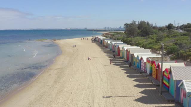 beautiful bathing houses on white sandy beach at brighton beach in melbourne, australia. - melbourne stock videos & royalty-free footage