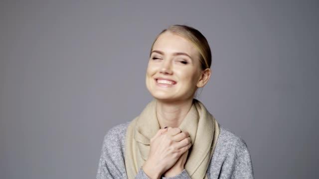 Beautiful blond female feeling hopeful with crossed fingers video