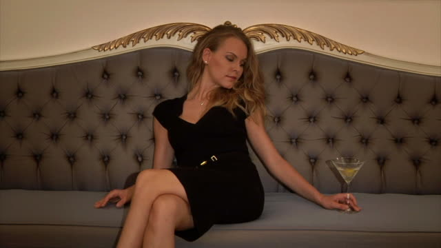 Beautiful Blonde Drinking and Relaxing  cross legged stock videos & royalty-free footage