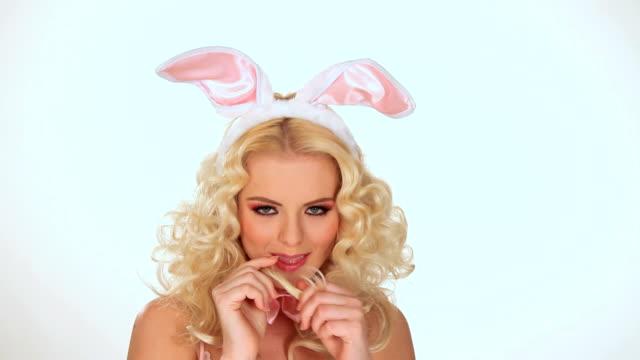 Beautiful blonde Easter Bunny posing video