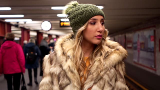Beautiful blonde girl walking through subway station Beautiful blonde girl walking through subway station at Berlin city center subway train stock videos & royalty-free footage