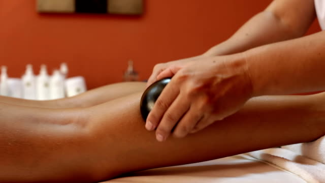 Beautiful blonde having  treatment with hot stones video