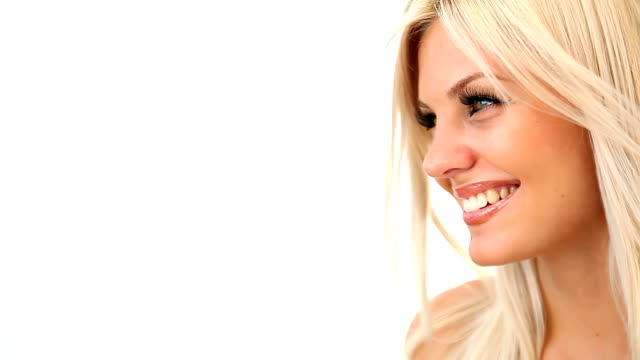 Beautiful blonde woman is laughing - studio shot video