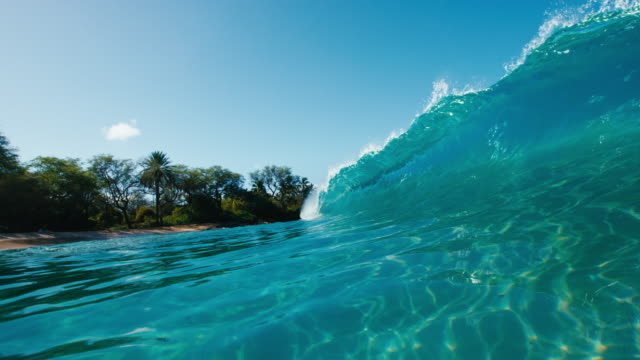 Beautiful blue ocean wave breaking in slow motion Beautiful blue ocean wave breaking in slow motion giant fictional character stock videos & royalty-free footage