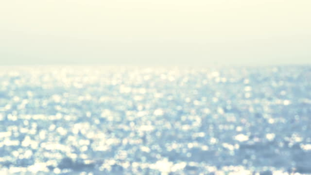 海 - シームレスなループから反射される太陽のまぶしさの美しいボケ味 - 光沢点の映像素材/bロール
