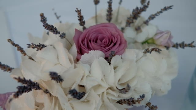 Beautiful bouquet of white hydrangeas and pink rose is in room video