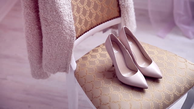 Beautiful bridal shoes in sunlight