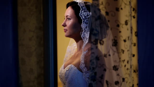 Beautiful bride in the window. Sequence 3 shot video