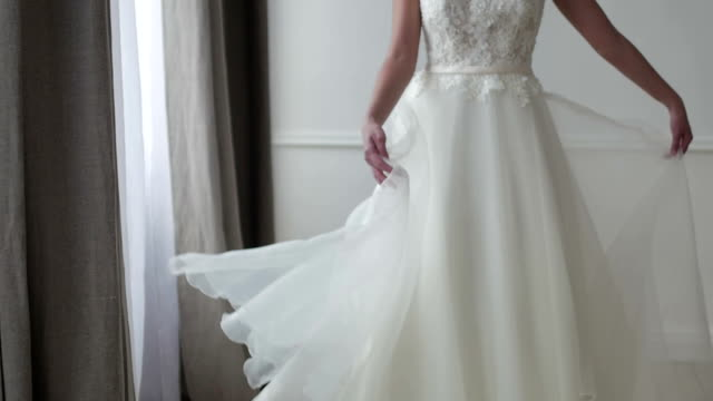 beautiful bride posing in her wedding dress - wedding fashion stock videos and b-roll footage