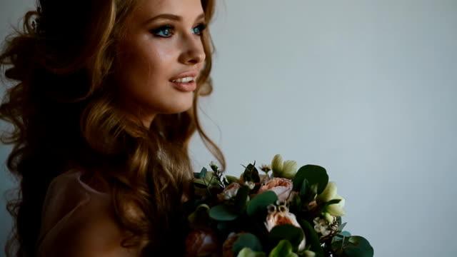 Beautiful bride posing near the window video