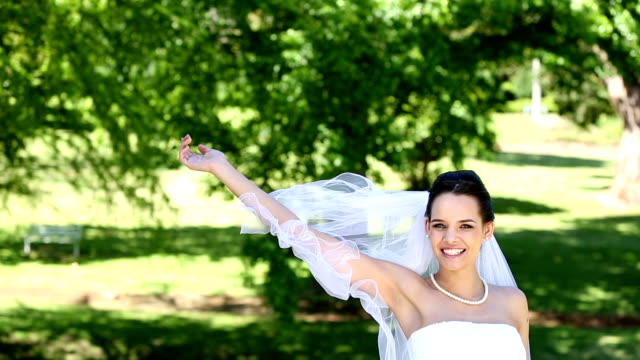 Beautiful bride throwing her bouquet video
