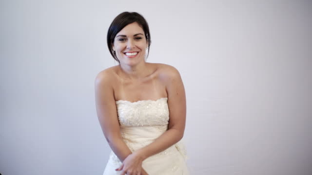 Beautiful Bride to be Smiling and Dancing of Happiness on her Wedding Dress video