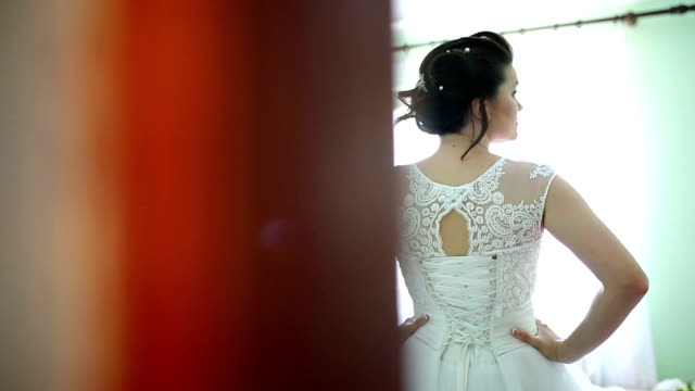 Beautiful brunette bride in wedding dress posing video