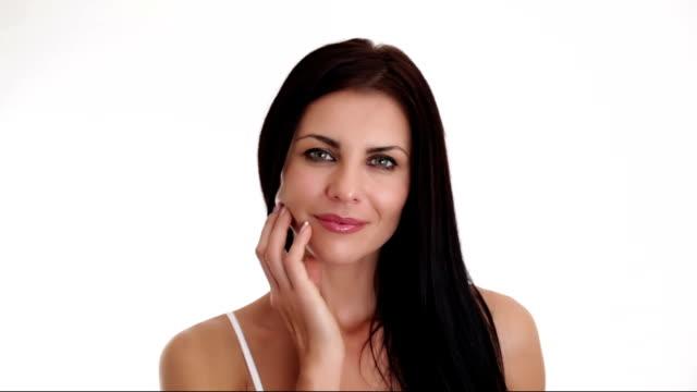 beautiful brunette looking at camera and posing - femininitet bildbanksvideor och videomaterial från bakom kulisserna
