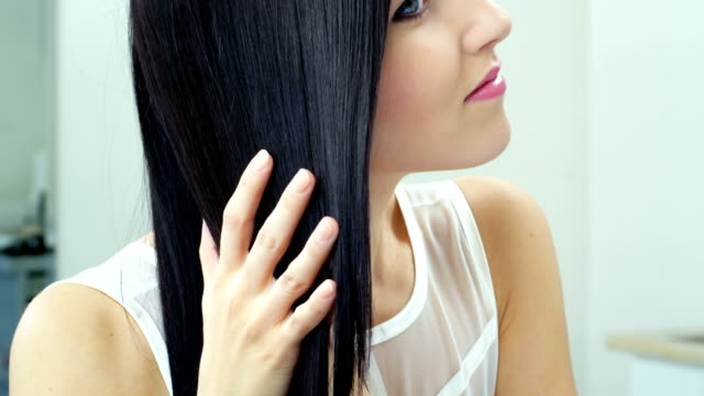 Beautiful brunette showing her shiny hair. video