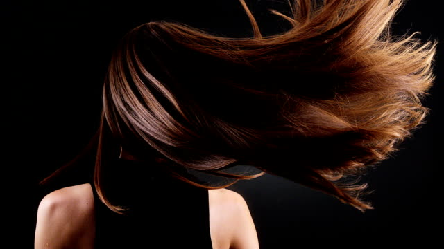 Beautiful brunette tossing her long hair Woman flipping her Dark shine hair. Rear view. Shot with camera Phantom. Super Slow motion. long hair stock videos & royalty-free footage