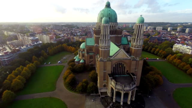 Beautiful Brussels from above National Basilica aerial city view. Beautiful aerial shot above Europe, culture and landscapes, camera pan dolly in the air. Drone flying above European land. Traveling sightseeing, tourist views of Belgium. video