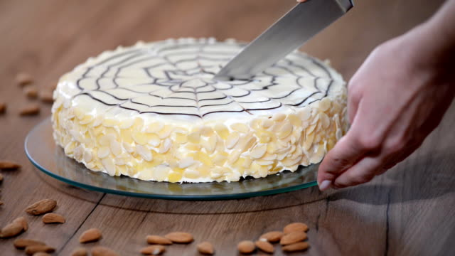 Beautiful cake of Esterhazy. Girl cook confectioner cuts a knife cake on slices video