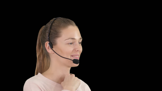 Beautiful call center operator with headset talking, Alpha Channel