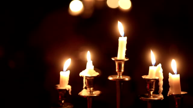 Beautiful candles and Hanukkah menorah with defocused background, dolly shot. video
