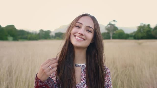 beautiful carefree young millennial woman smiling - brązowe włosy filmów i materiałów b-roll