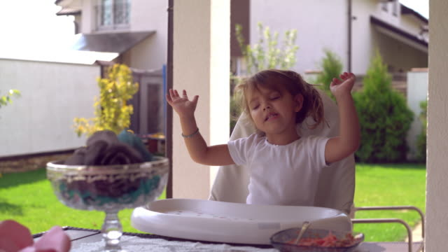 Beautiful child dance and sing at lunchtime outdoors video