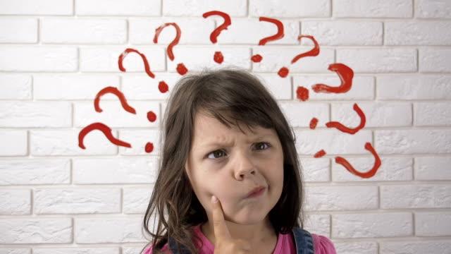beautiful child thinks. - question mark video stock e b–roll