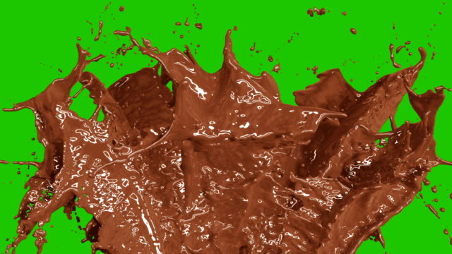 vídeos de stock e filmes b-roll de beautiful chocolate and coffee splashes in slow motion and freeze motion, alpha mask. flying through drops. useful for titles and intro. 3d animation food and health concept. - chocolate