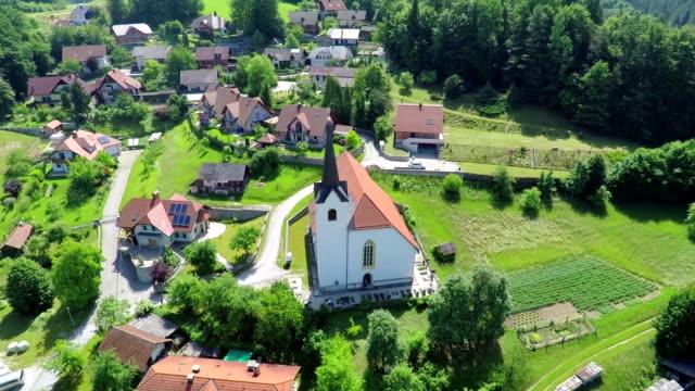 stockvideo's en b-roll-footage met mooie kerk in het dorp - heilig geschrift