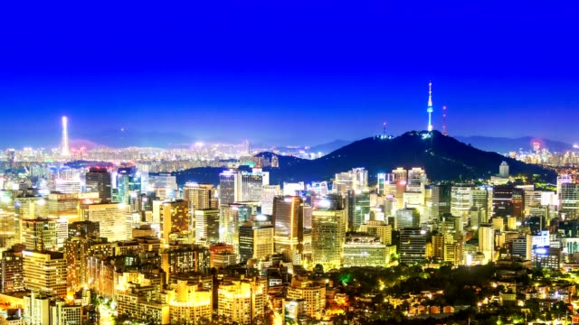 beautiful city in night, cityscape of seoul, south korea, seoul tower modern building and architecture at nighttime - corea del sud video stock e b–roll