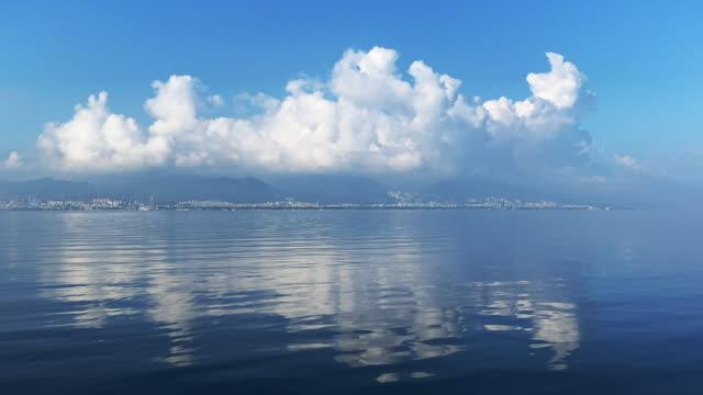 beautiful clouds over city and sea - morze egejskie filmów i materiałów b-roll