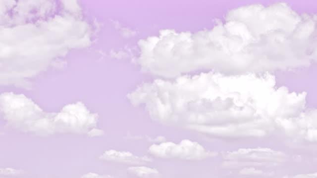 vackra moln med rosa himmel bakgrund. naturen väder, vita moln rosa himmel. - pink sunrise bildbanksvideor och videomaterial från bakom kulisserna
