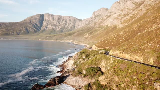Beautiful coastal road, Cape Town Aerial view over a coastal road near False Bay in Cape Town, South Africa cape peninsula stock videos & royalty-free footage