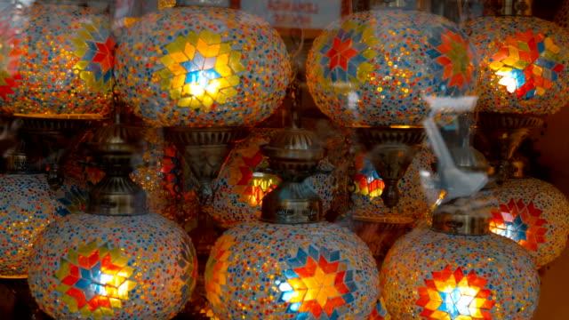 vackra färgglada elektriska lampor med ett traditionellt mönster i butiken - ramadan lykta bildbanksvideor och videomaterial från bakom kulisserna