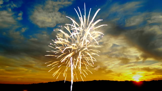 beautiful colorful fireworks on the sunset background of the independence day - luglio video stock e b–roll