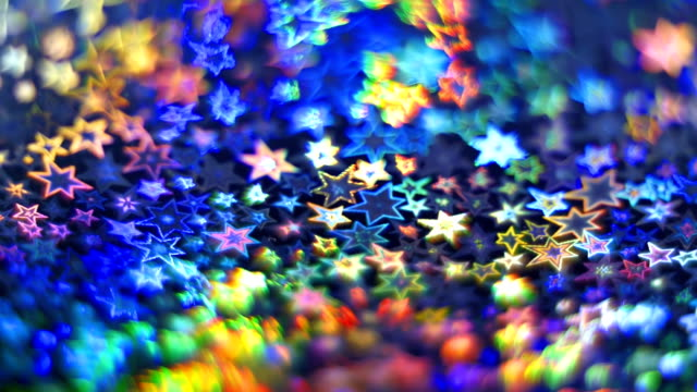 Beautiful colorful holographic stars as a background video