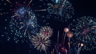 istock Beautiful colourful fire work display at night for celebration in festival 1195700679