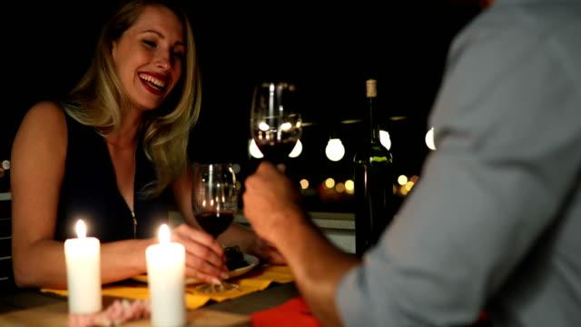 Beautiful couple in love having romantic dinner at night video