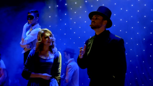 Beautiful couple sing duet song together People with a greasepaint and wearing scenic costumes are singing and dancing in the modern theatre. Modern performance with songs, dances and crazy heroes. stage theater stock videos & royalty-free footage