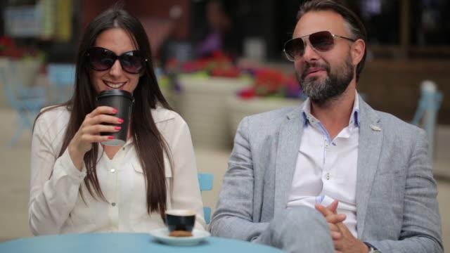 Beautiful Couple sitting a Manhattan cafe