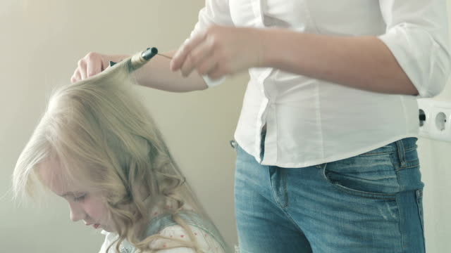 Beautiful curls of a little blonde girl. video